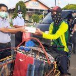 Dukung Operasi Kemanusiaan TNI AL, KKP Bagikan 850 Paket Ikan